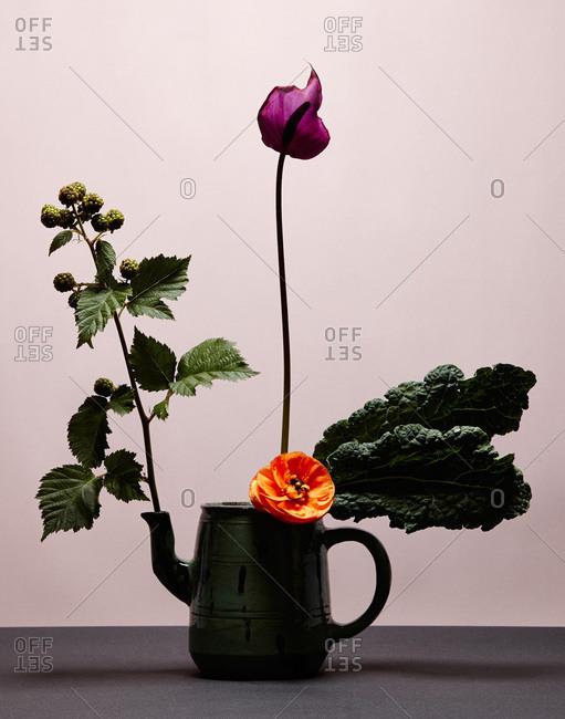 A lily and ranunculus flower arrangement