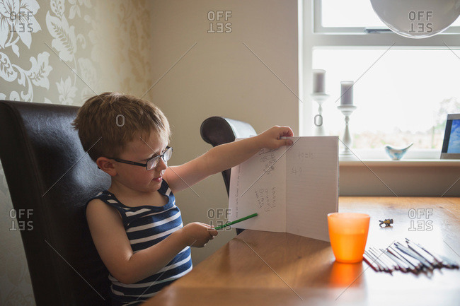A boy shows his homework progress