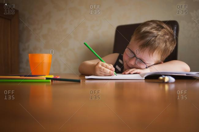 A boy works on his homework