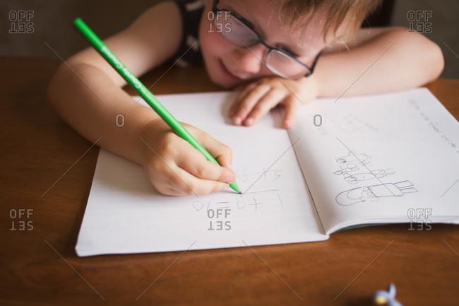 A boy works on math homework