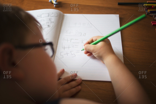 A boy works on his addition homework