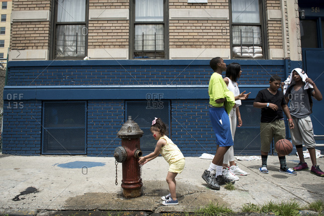 Bronx, New York, NY - July 8, 2015: Group of kids on city sidewalk in summer