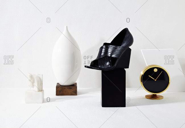 Shoe, vase and various items on blocks