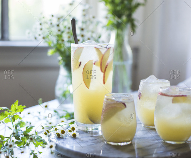 White nectarine prosecco sangria on a marble table