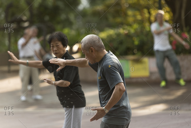 Hong Kong, China - June 11, 2015: Early morning Tai Chi