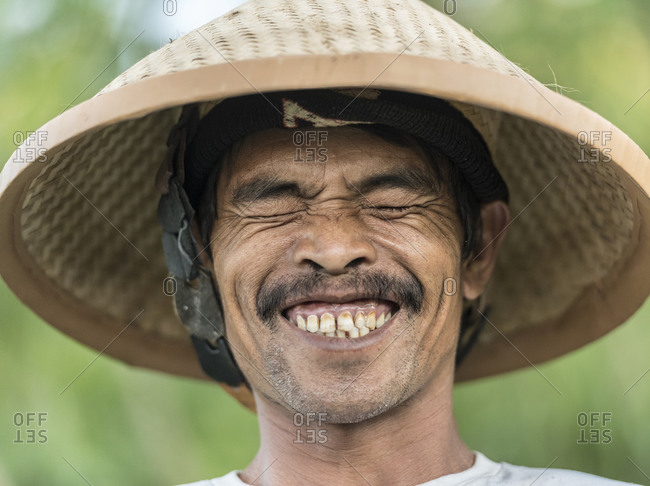 Java, Indonesia - June 16, 2015: Portrait of farmer in rural