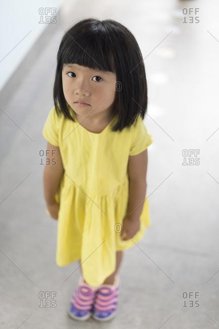 Chengdu, China - June 22, 2015: Portrait of girl in hallway of school