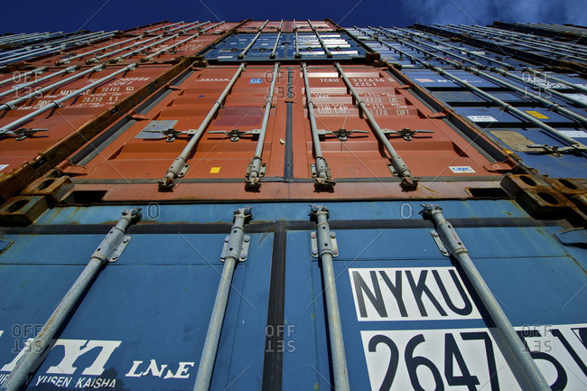 Auckland, New Zealand - June 27, 2011: Looking up at stacked shipping containers in Port of Auckland, New Zealand