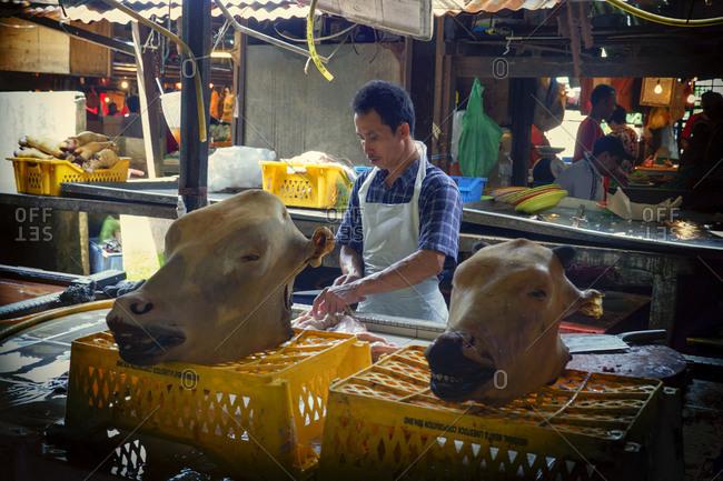 Kuala Lumpur, Malaysia - June 1, 2013: Cow heads at meat market in Kuala Lumpur