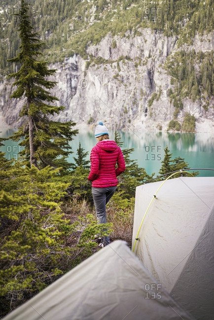 A woman walks away from her campsite in the mountains