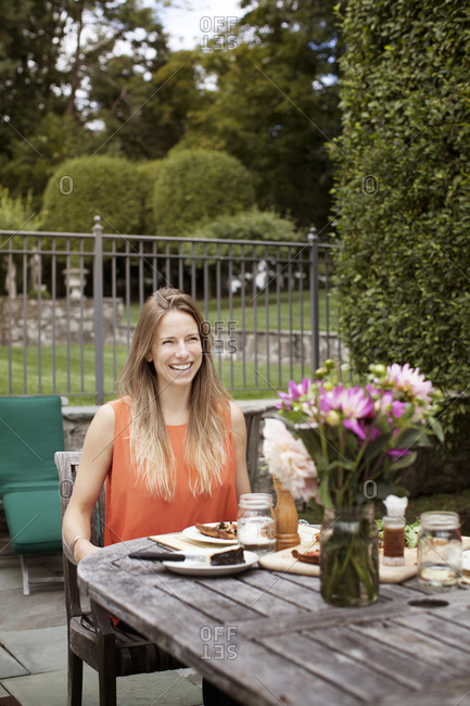 Woman dining al fresco at home