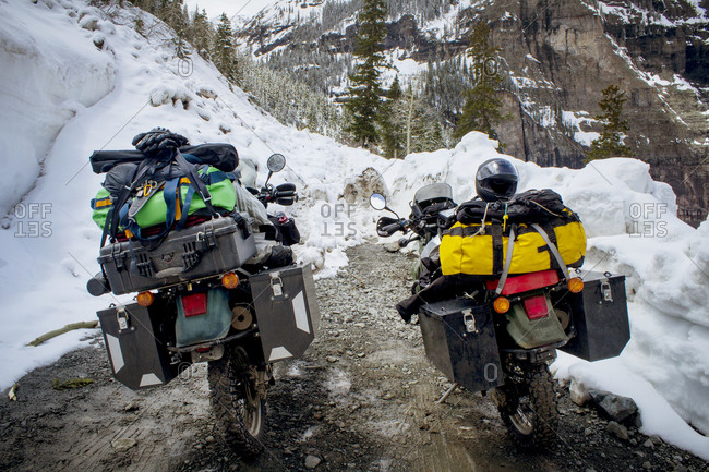 Motorcycles packed with travel gear in winter