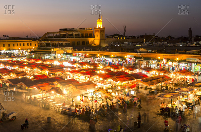 View to lighted Jemaa el-Fnaa bazaar in the evening, Marrakesh