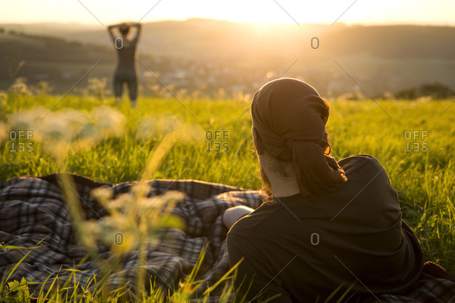 Couple on a meadow watching for sunrise