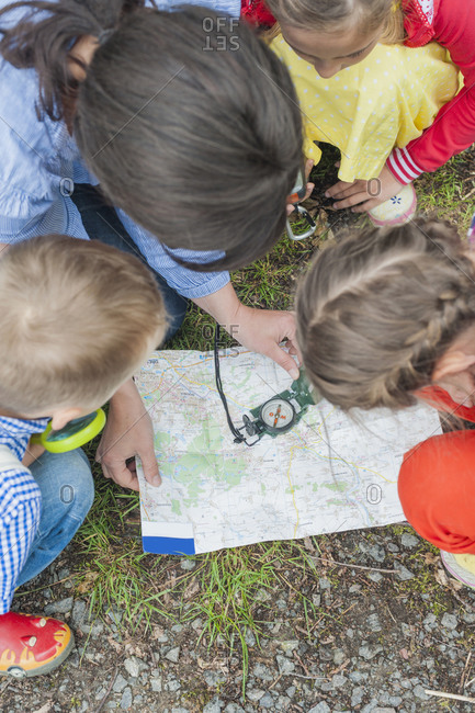 Children learning how to use compass and map