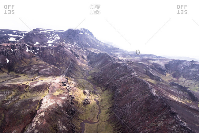 Rugged mountain peaks with snow in Iceland