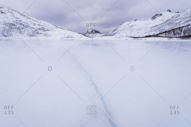 Frozen lake and mountains in Arctic