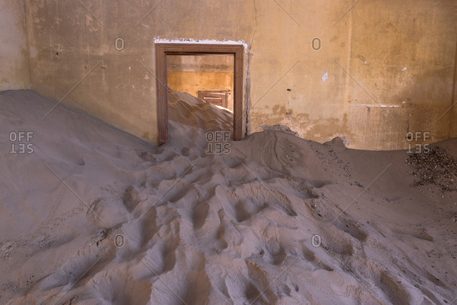 Abandoned building filled with sand in Namibia