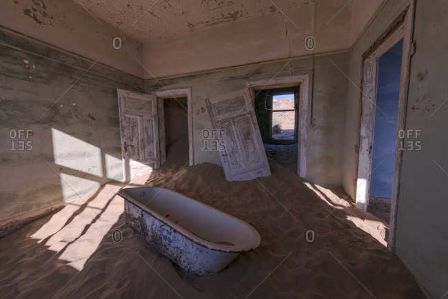 Deserted building interior with sand in Namibia