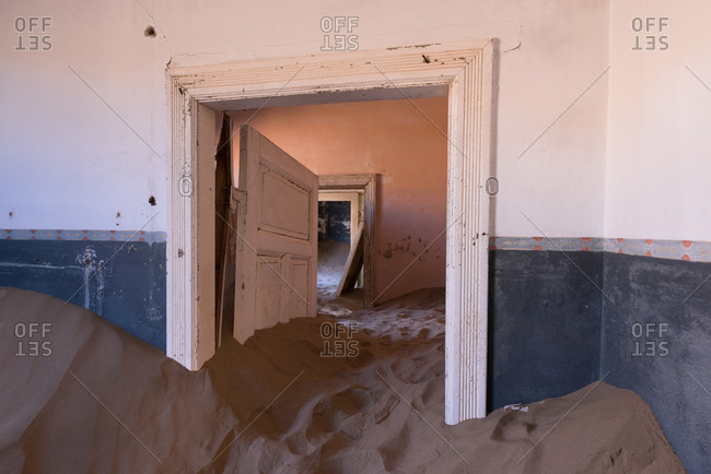 Abandoned building interior with sand in Namibia