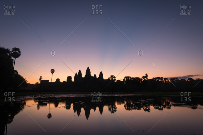 Temple silhouettes reflected in water