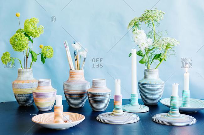 Orange and blue ceramic vases and candlesticks