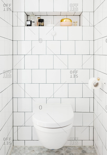 A white tile bathroom