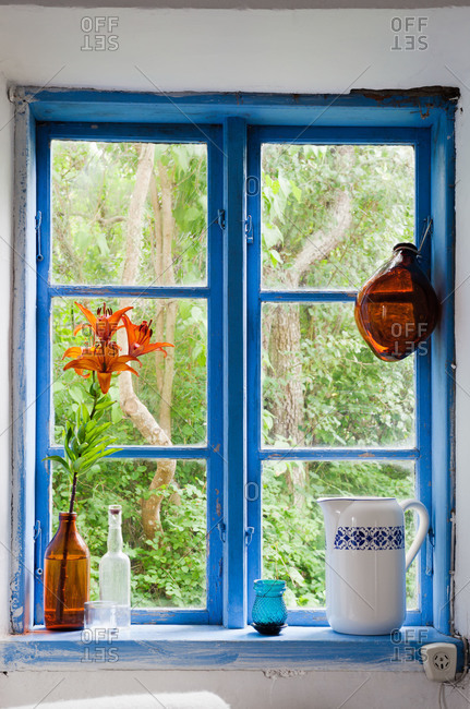 A window with a blue frame