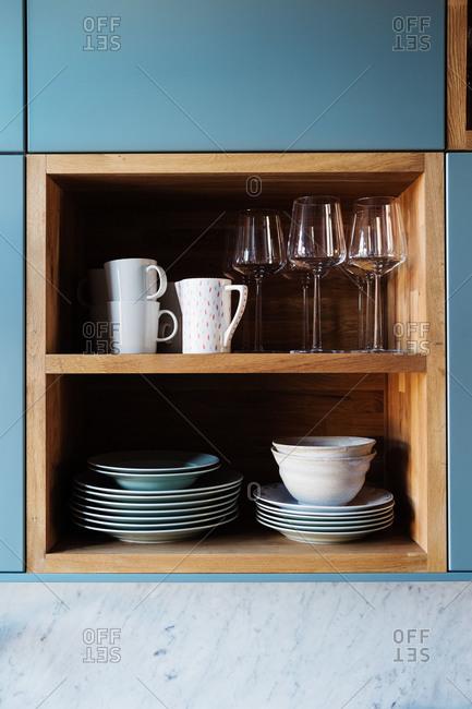A kitchen shelf with dishware