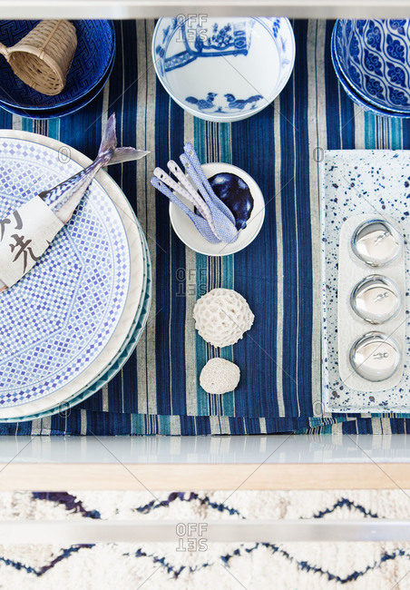 A table set with white and indigo dishware
