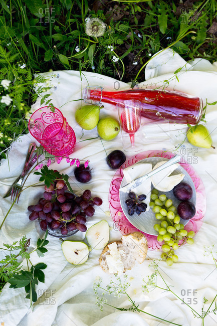A picnic of cheese and fruits