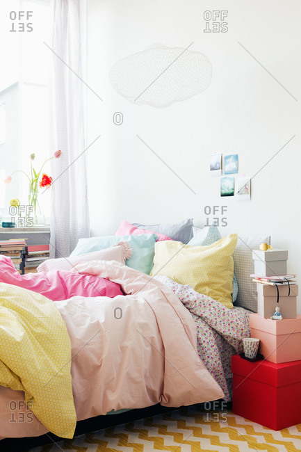 A brightly colored bed in a Swedish home