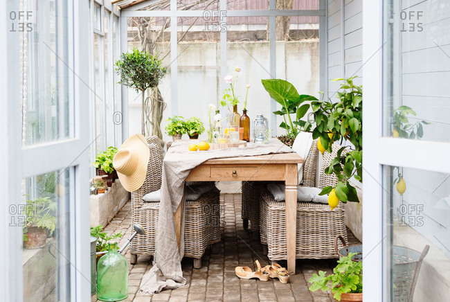 A table in a greenhouse in a Swedish home