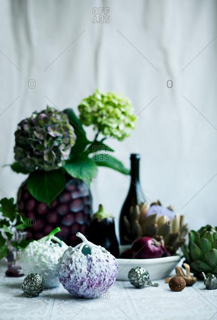 Hydrangeas and artichokes and ceramic models