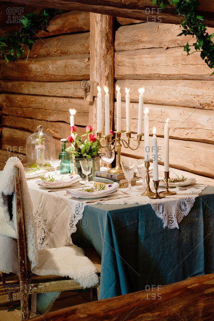 A table set with a candelabra in a wood cabin in Sweden