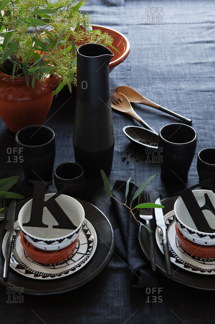 A table set with black dishware