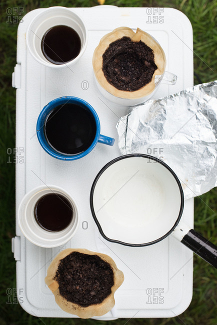 Coffee cups and drip cones at campsite