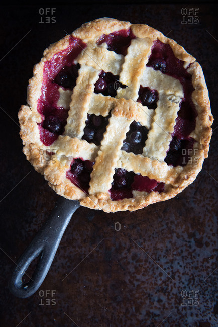 Lattice crust fruit pie in cast iron pan