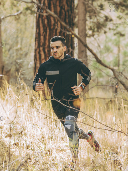 Man running in a forest