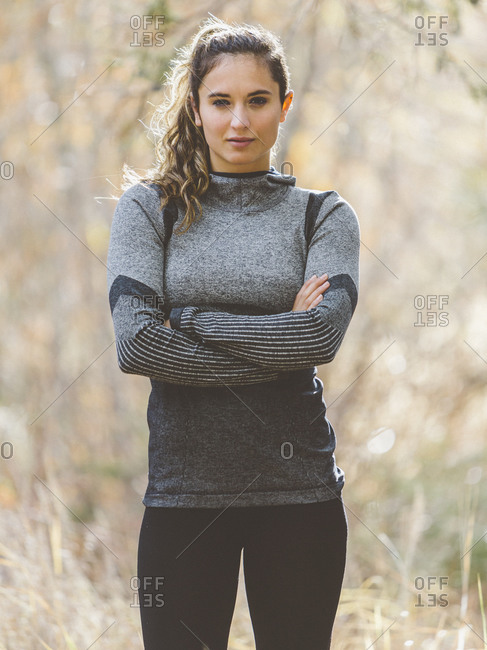 Woman in athletic clothing with arms crossed