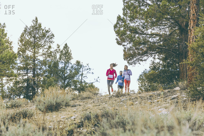 Three people jogging in the country