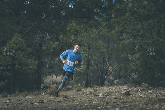 Man jogging in a forest clearing