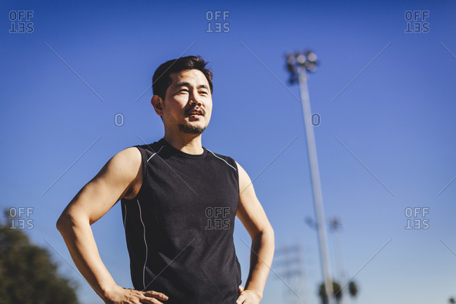 Asian male athlete standing in soccer field