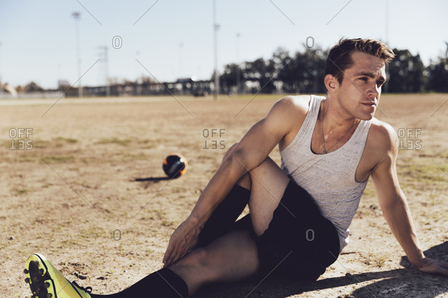 Man stretching in a soccer field