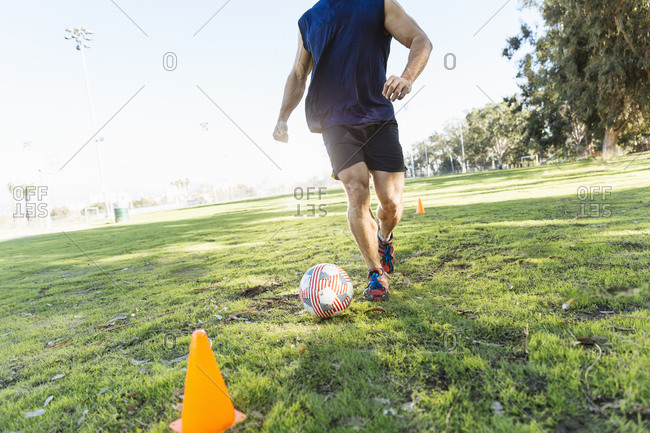 Man using cones in soccer training