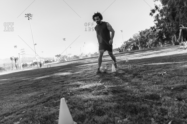 Man in soccer training with cones