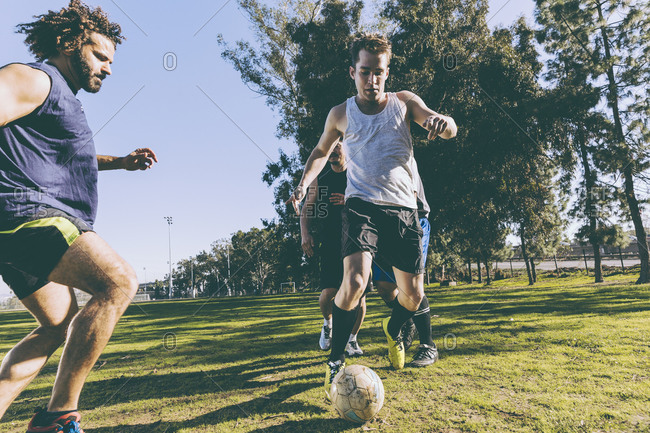 Men playing a game of soccer