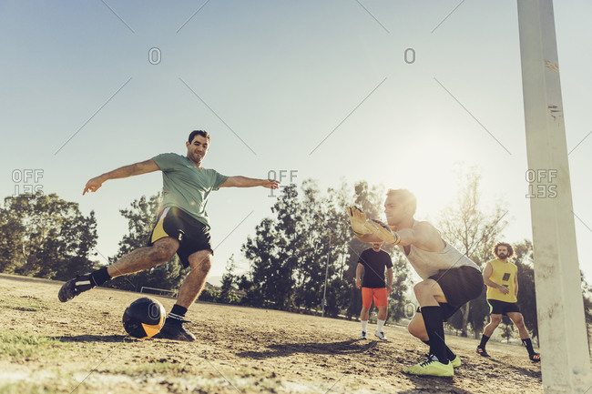 Man about to kick a goal during soccer match