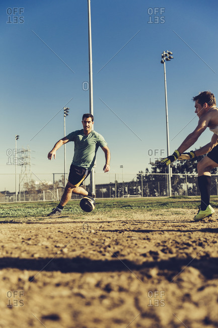 Man running for soccer ball during match