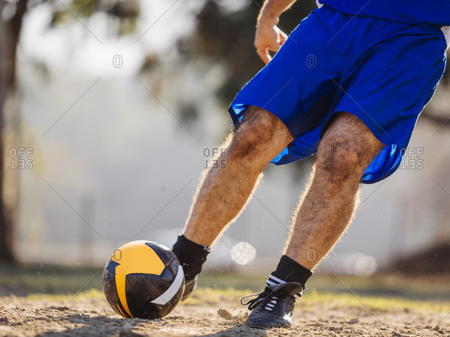 Male athlete kicking a soccer ball